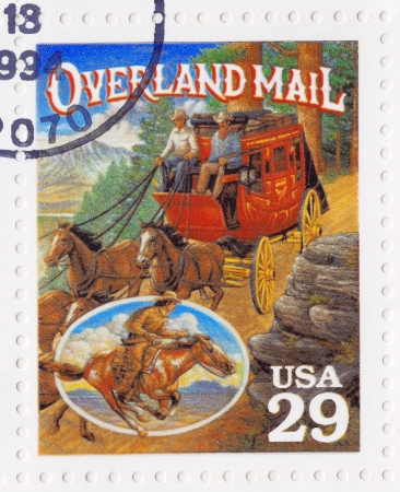 USA - CIRCA 1994   Stamp printed in the USA shows Overland Mail in the American Old West, circa 1994 Stock Photo - 16507453