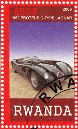 RWANDA - CIRCA 2009  stamp printed in Rwanda shows 1952 year Proteus C - Type Jaguar Car, circa 2009 Stock Photo - 16585950