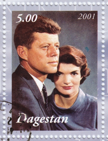 jfk: DAGESTAN - CIRCA 2001   Stamp printed in Dagestan shows John F Kennedy  L  with wife Jacqueline , circa 2001 Editorial