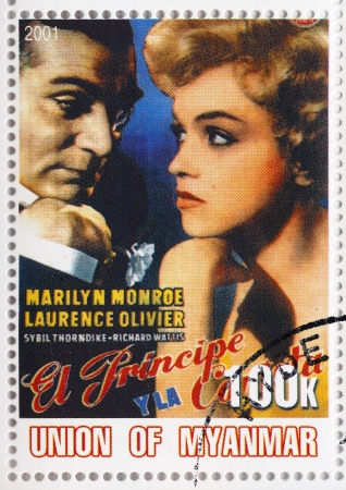 laurence: MYANMAR - CIRCA 2001   Stamp printed in Myanmar with popular 1960s American actress Marilyn Monroe and Laurence Olivier in The Prince and the Showgirl film poster, circa 2001