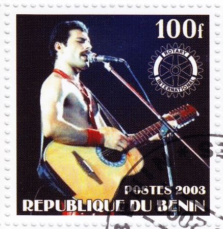 BENIN - CIRCA 2003   Stamp printed in Benin shows Freddie Mercury leader the Queen - 1980s famous musical pop group, circa 2003 Stock Photo - 16586016