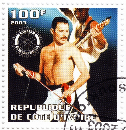 BENIN - CIRCA 2003   Stamp printed in Benin shows Freddie Mercury leader the Queen - 1980s famous musical pop group, circa 2003