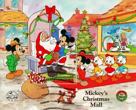 disney cartoon: DOMINICA - CIRCA 1988   Christmas stamp printed in Dominica shows Mickey with Santa, circa 1988 Editorial