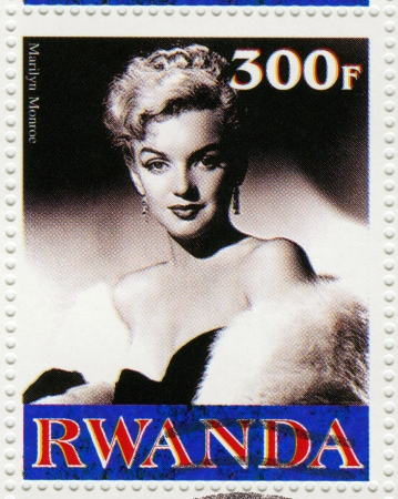 RWANDA - CIRCA 2003 : A stamp printed in Rwanda  showing Marilyn Monroe, popular actress in 1960s, circa 2003