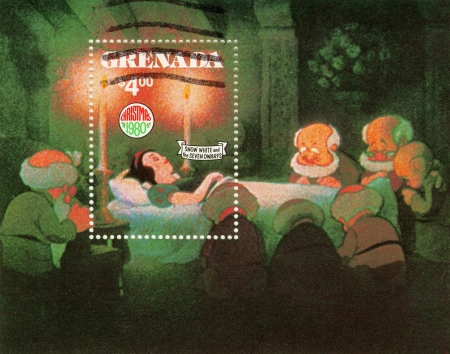 seven dwarfs: GRENADA - CIRCA 1980 : Christmas stamp printed in Grenada shows Snow White and The Seven Dwarfs cartoon, circa 1980