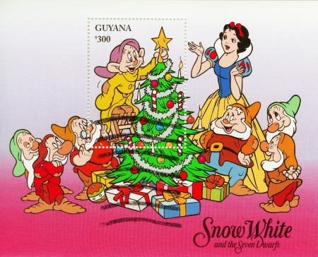seven dwarfs: GUYANA - CIRCA 1980 : Christmas stamp printed in Guyana shows Snow White and The Seven Dwarfs cartoon, circa 1980 Editorial