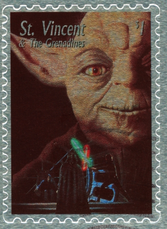 starwars: St. VINCENT - CIRCA 2003 : stamp printed in St.Vincent with poster Star Wars movie show Yoda and battle Dart Vader vs Luke Skywalker, circa 2003  Editorial