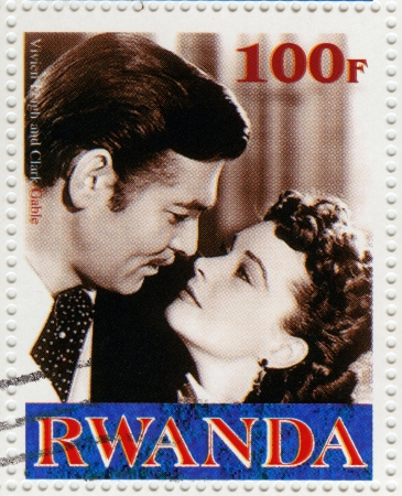 RWANDA - CIRCA 2000 : stamp printed in Rwanda with Vivien Lee and Clark Gable in Gone with the Wind film, circa 2000