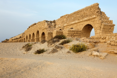 Roman aqueduct in Ceasarea at the coast of the Mediterranean Sea, Israel photo