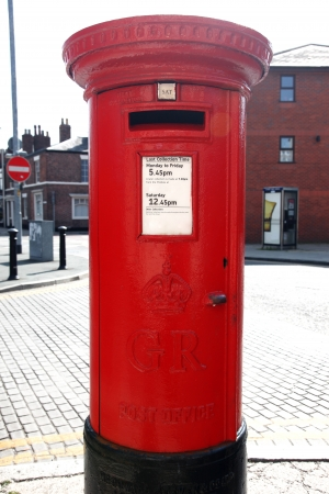 Traditional British Red Post Box on a London St photo