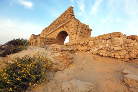ruins is ancient: Ancient Roman aqueduct in Ceasarea at the coast of the Mediterranean Sea, Israel Stock Photo