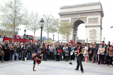 aerobica: PARIS - APRIL 27   B-boy doing some breakdance moves in front a street crowd, at Arch of Triumph, April 27 2013, Paris, France