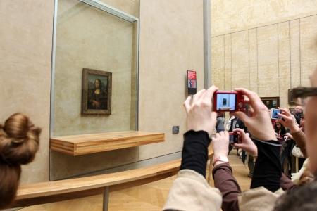 leonardo davinci: PARIS - MAY 3  Visitors take photo of Leonardo DaVinci