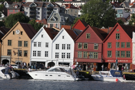 largest: BERGEN, NORWAY - CIRCA JULY 2012: Tourists and locals stroll along the UNESCO World Heritage Site, Bryggen, July 2012 in Bergen. Bergen is the second largest city in Norway Population (2013) - 268,700