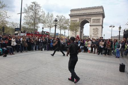 PARIS - APRIL 27:: B-boy doing some breakdance moves in front a street crowd, at Arch of Triumph, April 27 2013, Paris, France