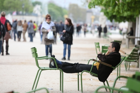 PARIS, FRANCE - APRIL 27  Local and tourist walking and relax in Tuileries Garden  Jardin des Tuileries was created by Catherine de Medicis in 1564, in Paris, France April 27, 2013