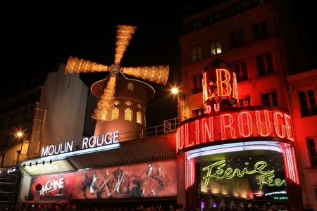 PARIS - MAY 3  The Moulin Rouge at night, on May 3, 2013 in Paris, France  Moulin Rouge is a famous cabaret built in 1889, located in the Paris red-light district of Pigalle