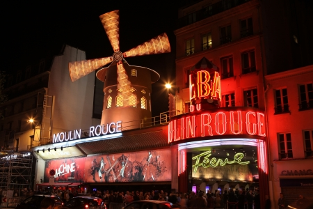 moulin: PARIS - MAY 3: The Moulin Rouge at night, on May 3, 2013 in Paris, France. Moulin Rouge is a famous cabaret built in 1889, located in the Paris red-light district of Pigalle