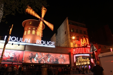 PARIS - MAY 3: The Moulin Rouge at night, on May 3, 2013 in Paris, France. Moulin Rouge is a famous cabaret built in 1889, located in the Paris red-light district of Pigalle