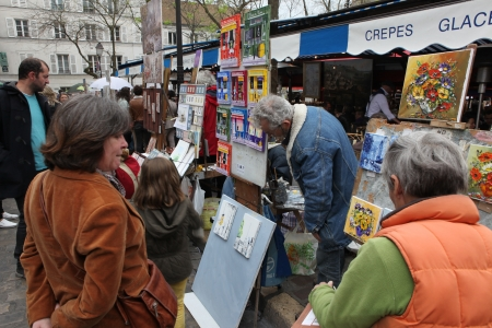 Public painter and buyer on Montmartre hill in Paris circa 1 May 2013 in Paris, France  Many artists worked around the community of Montmartre such as Pablo Picasso or Vincent van Gogh Stock Photo - 21839687