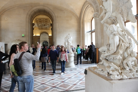 Visitors at the Louvre Museum, in Paris, France  Louvre is the biggest Museum in Paris displayed over 60,000 sq M  of exhibition space and very popular culture site in the world