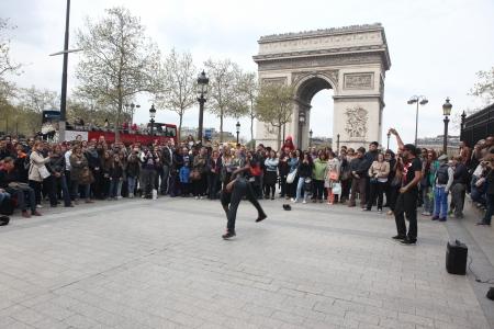 aerobica: PARIS - APRIL 27:: B-boy doing some breakdance moves in front a street crowd, at Arch of Triumph, April 27 2013, Paris, France