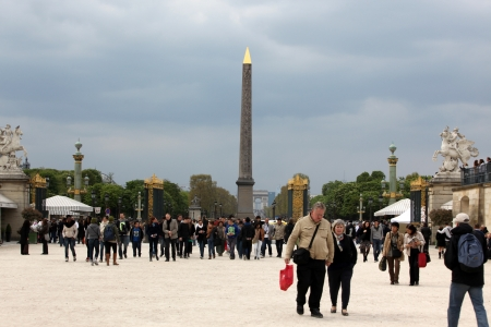 PARIS, FRANCE - APRIL 24: Luxor Obelisk and triumphal arch from Tuileries Garden. Jardin des Tuileries was first opened to the public in 1667 and very popular site, in Paris, France on April 24, 2013
