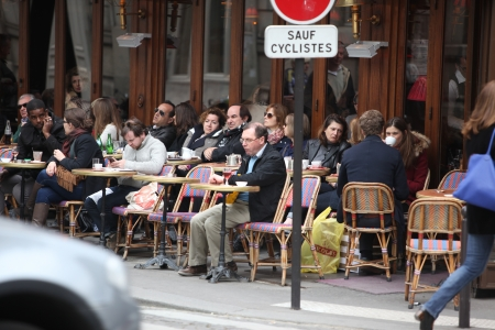 PARIS - APRIL 27 : Parisians and tourist enjoy eat and drinks in cafe sidewalk in Paris, France on April 27, 2013. Paris is one of the most populated metropolitan areas in Europe