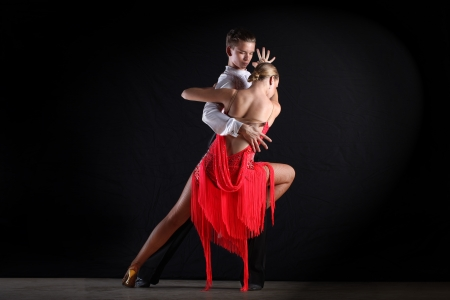dancers in ballroom against black background photo