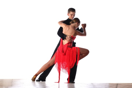 latin people: Latino dancers in ballroom isolated on white Stock Photo