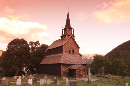Sunset at old Kaupanger Stave Church, Norway photo