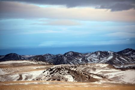 alpenglow: Winter Mt and clouds sky at sunset, Montana, USA Stock Photo