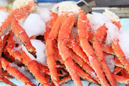 Fresh crab legs at a seafood market photo