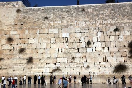 JERUSALEM, ISRAEL - OCTOBER 28: People at the Wailing Wall where Jewish worshipers pray. The most holy site for Jews. October 28, 2010 in Jerusalem, Israel.