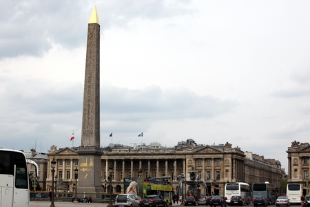 27 years old: PARIS - APRIL 27: Citizen and tourist at Fountains and Obelisk, Place de la Concorde, April 27, 2013 in Paris. Obelisk of Luxor is more than 3,300 years old and was given to France in 1829