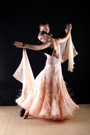 Latino dancers in ballroom isolated on black photo
