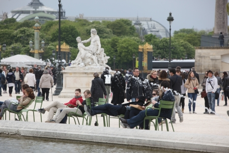 PARIS - APRIL 24: Local and Tourist in the famous Tuileries garden on April 24, 2012 in Paris. Tuileries Garden is a public garden located between the Louvre Museum and the Place de la Concorde and very popular sitte