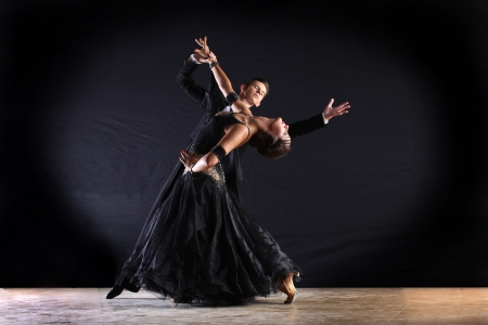 Latino dancers in ballroom isolated on black