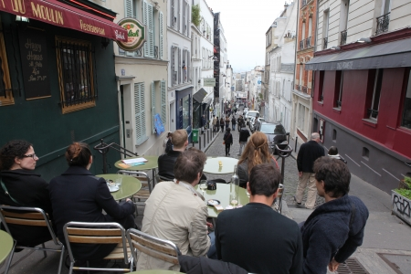 PARIS - MAY 1: View of typical paris cafe on May 1, 2013 in Paris. Montmartre area is among most popular destinations in Paris, many artists worked around the community of Montmartre such as Pablo Picasso or Vincent van Gogh Stock Photo - 22564276