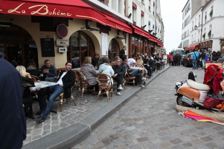 PARIS - MAY 1: View of typical paris cafe on May 1, 2013 in Paris. Montmartre area is among most popular destinations in Paris, many artists worked around the community of Montmartre such as Pablo Picasso or Vincent van Gogh Stock Photo - 22564283