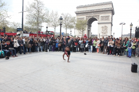 aerobica:  B-boy doing some breakdance moves in front a street crowd, at Arch of Triumph, Paris, France Editorial