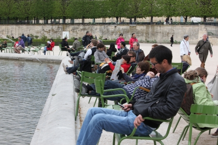 Local and Tourist in the famous Tuileries garden in Paris  Tuileries Garden is a public garden located between the Louvre Museum and the Place de la Concorde and very popular sitte