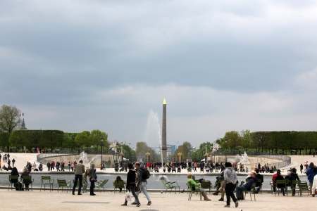 Luxor Obelisk and triumphal arch from Tuileries Garden  Jardin des Tuileries was first opened to the public in 1667 and very popular site, in Paris, France
