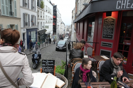 pablo picasso: View of typical paris cafe in Paris  Montmartre area is among most popular destinations in Paris, many artists worked around the community of Montmartre such as Pablo Picasso or Vincent van Gogh