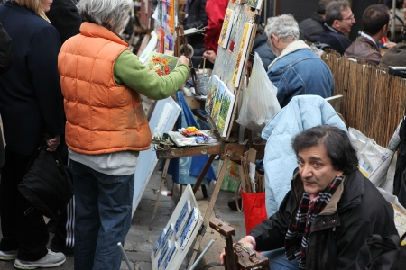 Public painter and buyer on Montmartre hill in Paris circa 1 May 2013 in Paris, France  Many artists worked around the community of Montmartre such as Pablo Picasso or Vincent van Gogh