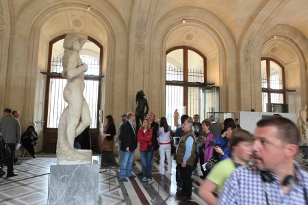 PARIS - MAY 3: Visitors at the Louvre Museum, May 3, 2013 in Paris, France. Louvre is the biggest Museum in Paris displayed over 60,000 sq.M. of exhibition space and very popular culture site in the world