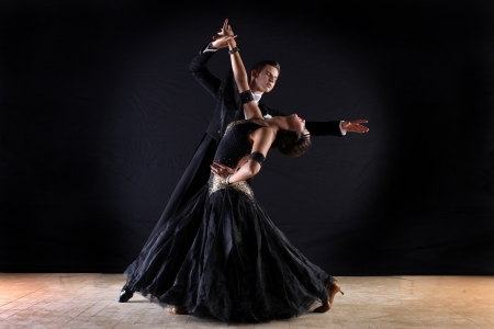 tango dance: Latino dancers in ballroom isolated on black background