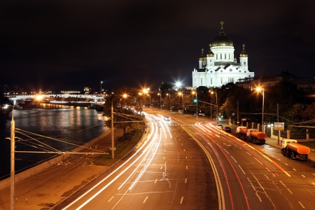 moskva river: Beautiful Night View Cathedral of Jesus Christ the Saviour and Moskva river through night traffic and rays of lamp with Kremlin riverside in the summer