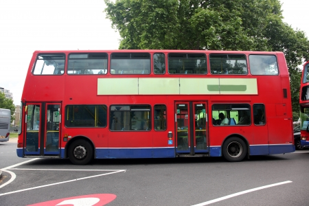 route master bus: Route Master Bus in the street of London. Route Master Bus is the most iconic symbol of London as well as Londons Black cabs. Stock Photo