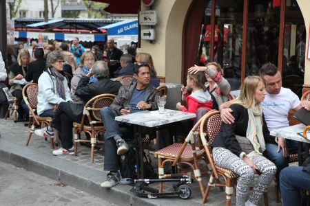 PARIS - MAY 1: View of typical paris cafe on May 1, 2013 in Paris. Montmartre area is among most popular destinations in Paris, many artists worked around the community of Montmartre such as Pablo Picasso or Vincent van Gogh